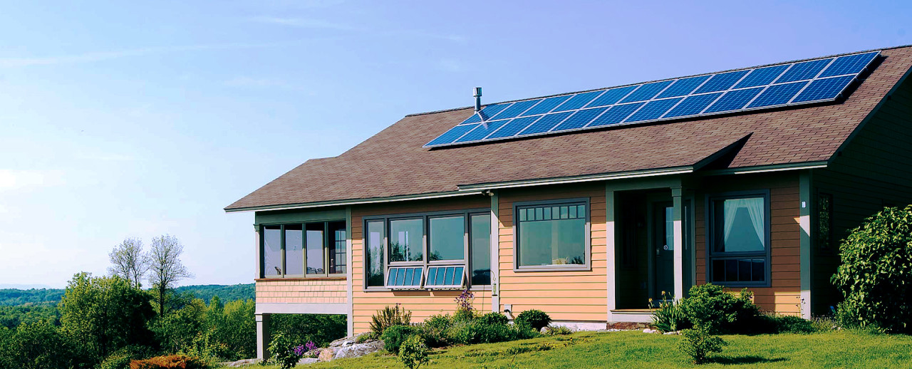 Image of a nice home on a hill top with solar panels